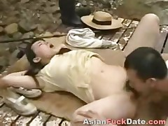 Chinese couple banging in public park