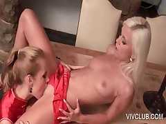 Lesbo eating pussy on the table