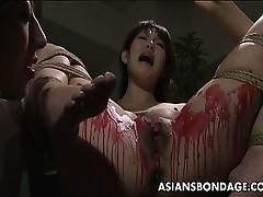 Oriental sweetheart acquire her privates overspread in wax.