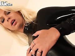 Brunette hair and blonde women in black latex caress
