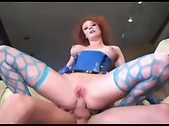 Redhead pumping in fencenet nylons and latex