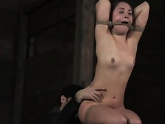 Nipple torment in over arm tie position