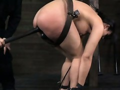 Suspended sub spanked and toyed