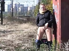 Hot babes get off pants for a pee in public