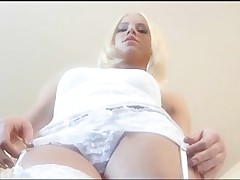 Breathtaking blond babe stripping and masturbating