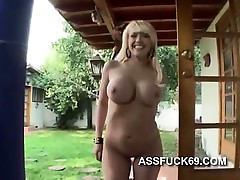 Long haired blonde shows her anus