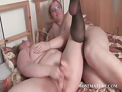 Aged BBW lesbians making out in bed