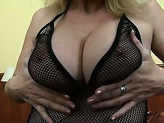 Busty MILF playing with hard teats