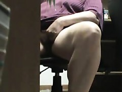 Mum caught masturbating beneath the desk