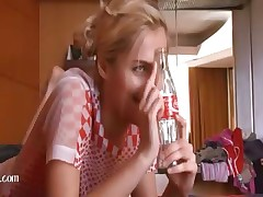 Russian blonde woman using coca cola