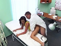 Doctor pumping his pretty patient from behind