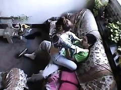 Pair fucks in the living room of house