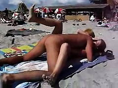 Pair having sex on the nude beach