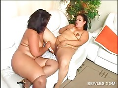 Brunette BBW lesbian babes share sex toys and hot licks