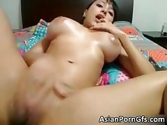 Busty asian slut rubbing wet shaved